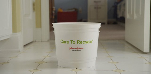A bucket labelled Care to Recycle on the floor